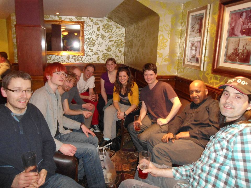Smiling people sitting in Wetherspoons pub